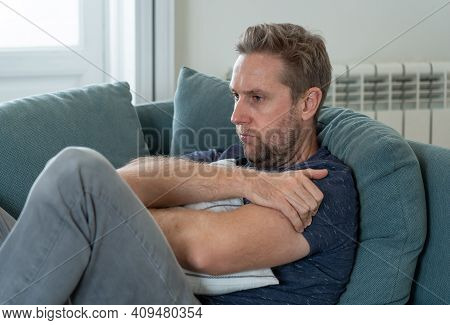 Unhappy Depressed Caucasian Male Crying In Living Room Couch Feeling Desperate And Lonely Isolated A