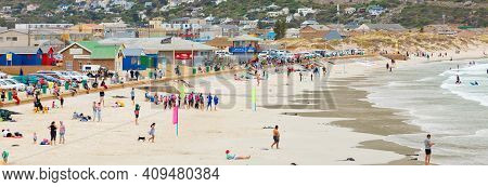 Swimmers Frolicking In The Shallow Waves Of Fish Hoek Beach