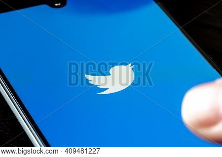 Vilnius, Lithuania - February 23 2021: Twitter App Displayed On The Smartphone With Finger. Twitter