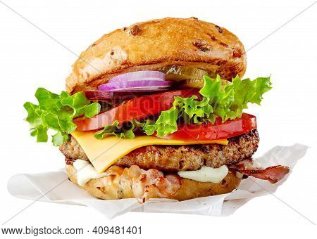 Delicious Grilled Burger With Cheese, Salad And Tomatoes On A Sesame Bun. Fast Food Hamburger