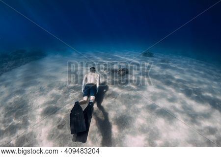 Sporty Man Freediver Dive With Fins, Underwater In Tropical Sea.