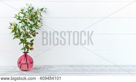 Elegant Home Spring Flower Decor, Twig Flower Bouquet. Blooming Spring Branches Of Flowers In Glass