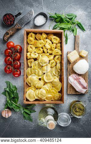 Italian Raw Handmade Ravioli With Fresh Ingredients, Basil, Pesto, Ham, Mozzarella Cheese, Parmesan