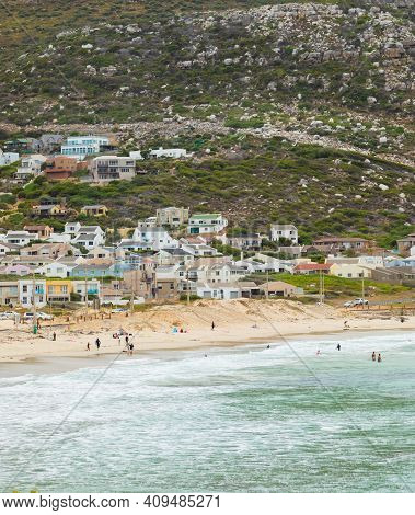 Swimmers Frolicking In The Shallow Waves Of Glencairn Beach