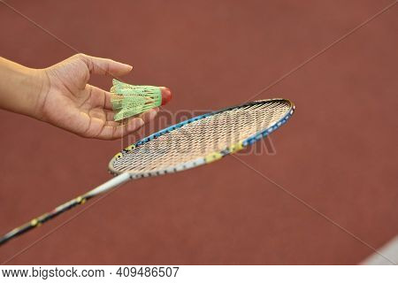 Female Child Hand Holding Badminton Racquet And Shuttlecock
