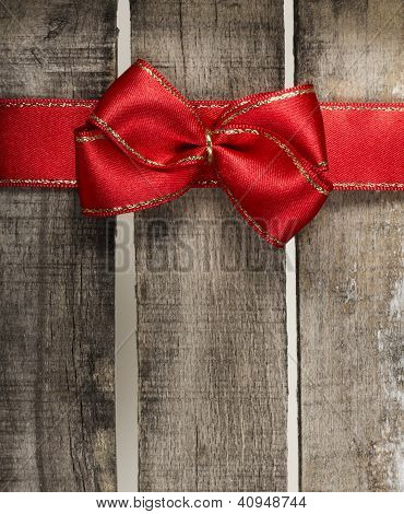 Red Ribbon On Old Wooden Background