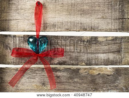 Turquoise Heart On Old Wooden Background