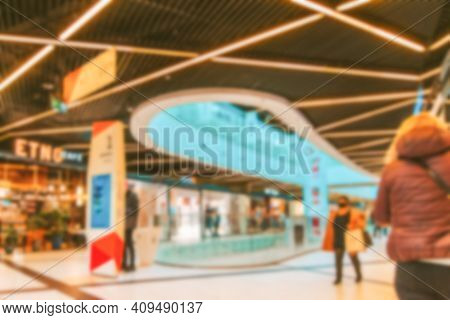 Shopping Mall Entrance Blurred Background. People Shopping In Modern Commercial Mall Center. Interio