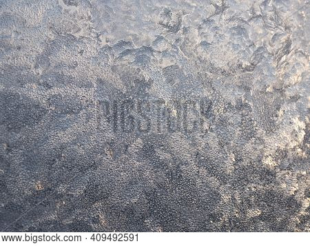 Glowing Texture Of Window Ice. Crystalline Frosting Background