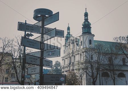 Krakow, Poland - October, 2015: Sign Indicating The Directions And Distances To Cities In Krakow. Th
