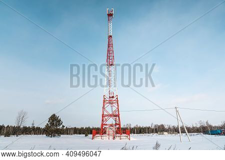 New Telecommunication Antenna On Background Of Blue Sky In The Forest Winter. Satellite Dish Telecom