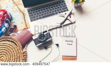 Traveler Planning Vacation Trip And Searching Information Or Booking Hotel On Laptop With Accessorie