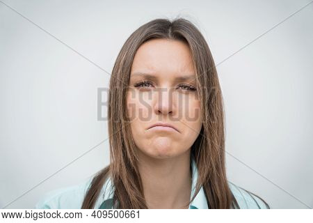 Sad Unhappy And Disappointed Woman Face. Young Woman Frowning Face. Facial Expression Of Feeling Sad