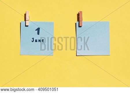 June 1st . Day Of 1 Month, Calendar Date. Two Blue Sheets For Writing On A Yellow Background. Top Vi