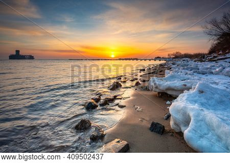 Baltic Sea beach in Babie Doly at sunrise. Gdynia, Poland