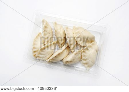 Top View Of Pierogi, Dumplings On A Plastic, Transparent Food Tray, Isolated On White.