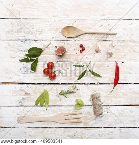 A Rustic Composition With Fresh Herbs On Wooden Boards, Top View.
