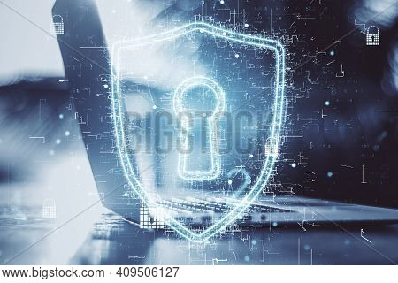Intellectual Property Protection Concept With Digital Glowing Keyhole Sign And Opened Laptop At Abst