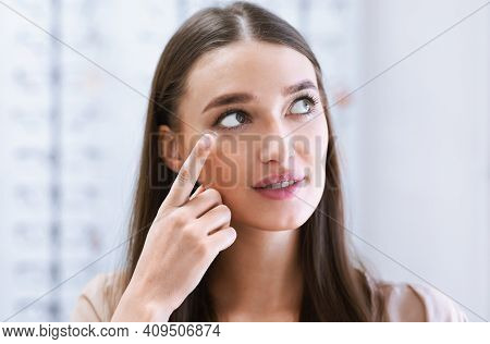 Ophthalmology And Vision Correction. Closeup Portrait Of Young Woman Applying Eye Lens. Smiling Fema