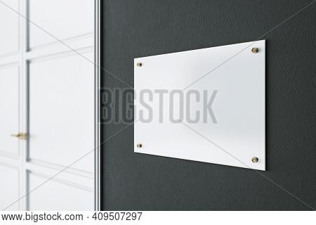 Light Blank Signage On Dark Wall Before The Entrance A Room With White Door. Mockup. 3d Rendering