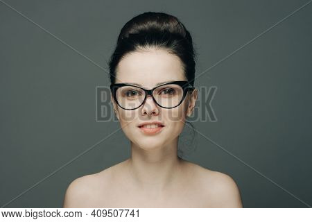 Attractive Woman With Bare Shoulders Wearing Glasses Glamor Fashion Gray Background