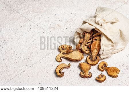 Forest Dried Edible Mushrooms In A Linen Sack