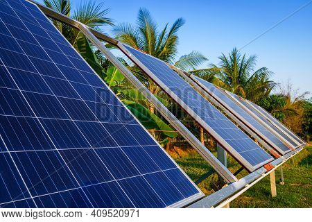 Power Solar Panel For Agriculture In A Rural Houses Area Agricultural Fields Blue Sky Background,agr