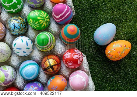 Easter Holiday Concept,colorful Easter Eggs In Egg Box,basket Easter Eggs In Green Grass Background