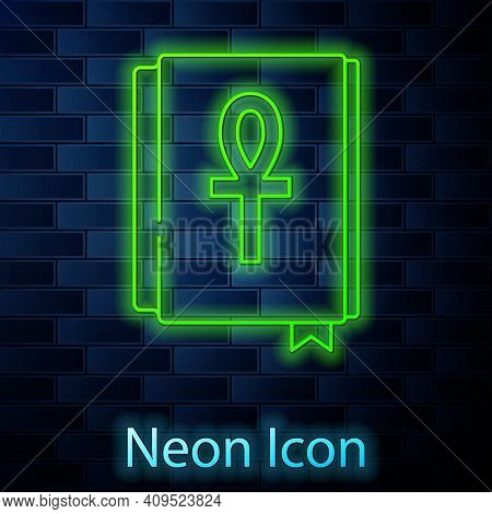 Glowing Neon Line Cross Ankh Book Icon Isolated On Brick Wall Background. Vector