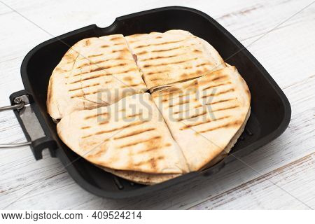 Tortilla With Cheese And Ham. Pita With Grated Cheese, Ham, Tomatoes On A Grill Pan.