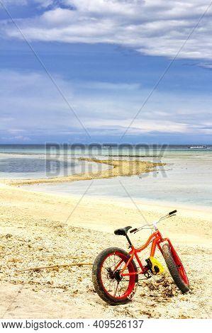 Gili Air Island In The Indian Ocean. 03.01.2017 Beach Bike With Wide Tires. Coral Beach.