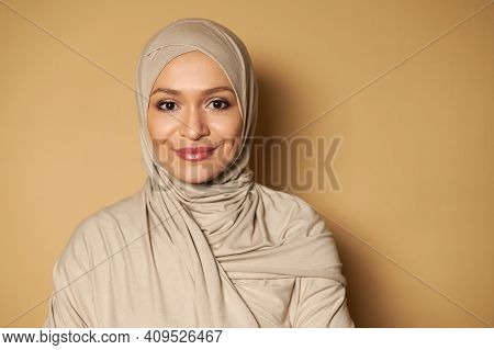 Portrait Of Beautiful Arab Muslim Woman Wearing Hijab. Strict Formal Outfit And Elegant Appearance.