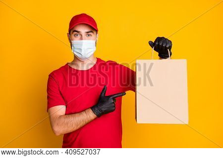 Portrait Of Nice Healthy Guy Wear Gauze Mask Demonstrating Bringing Cafe Order Contactless Takeout I