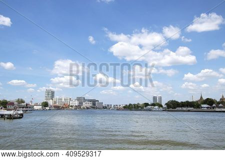Views Of The Chao Phraya River And The City On Both Sides Of The River In Bangkok In Thailand.