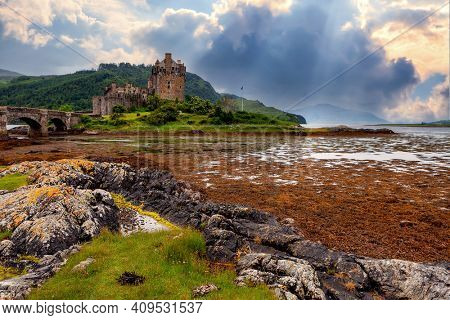 Beautiful lake and castle on the hill at sunset