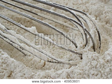 Wire Whisk In Unbleached Flour