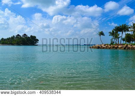 Tropical Island Landscape, Turquoise Ocean, Blue Sky With White Clouds On Sunny Summer Day. Sentosa