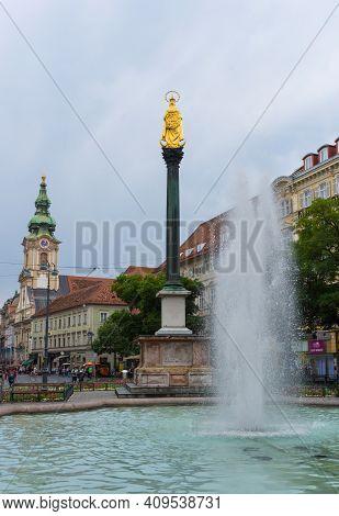 Graz/austria - June 22, 2019: Mary's Column In Jakominiplatz Square And Parish Church (stadtpfarrkir