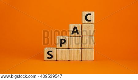 Spac, Special Purpose Acquisition Company Symbol. Businessman Holds Cubes With Word 'spac' On Beauti