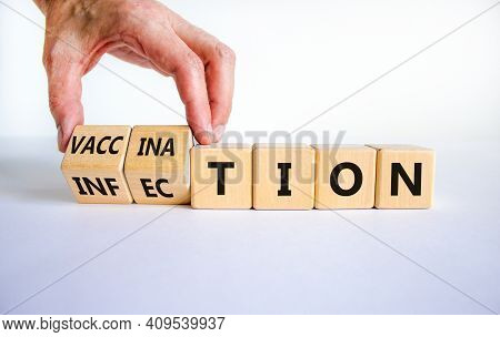 Vaccination Vs Infection Symbol. Doctor Turns Wooden Cubes And Changes The Word 'infection' To 'vacc