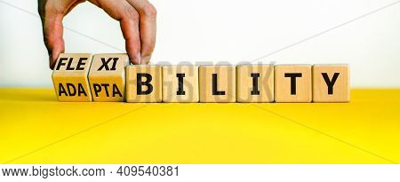 Flexibility And Adaptability Symbol. Businessman Turns Wooden Cubes And Changes Words 'adaptability'