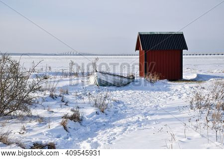 View At The Oland Bridge In Sweden By An Old Rowing Boat And A Red Fishing Shed