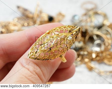 Jeweler Looking At Jewelry Through Magnifying Glass, Jewerly Inspect And Verify, Closeup
