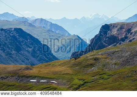 Awesome Alpine Landscape With Great Snowy Mountain Behind Rocky Mountains And Deep Gorge. Giant Rock
