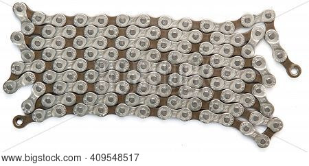 Krasnodar, Russia - February 12, 2021: New M-wave 8-speed 116-link Bicycle Chain Isolated On White B