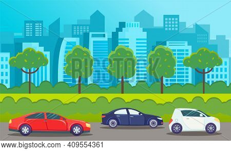 Cars Drive On An Asphalt Road Against The Background Of Tall Buildings Of The City Landscape. Panora