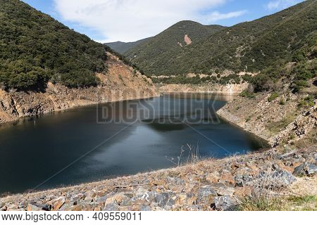 Landscape Of A Lake, Reservoir, In Catalonia, Spain, In Summer. Sunny Day And Green Plants. Vallforn
