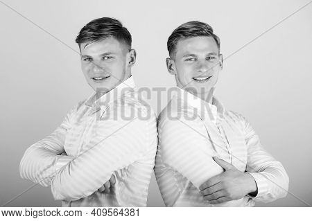 Two Brothers Smiling. Happy Men With Hands Folded. Models Gays Standing Together. Twins Wearing Shir