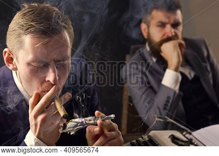 Man Lighting Cigar From Burning Dollar Banknote. Business Meeting. Gangster And Money. Concept Of Cr