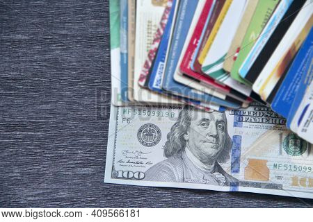 Hundred Dollar Notes And Credit Cards. Pile Of Credit Cards In Dollars. Cash And Non-cash Money. Pla